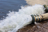 Water flows from the pipe — Stock Photo
