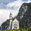 Hidden in the mountains Neuschwanstein castle — Stock Photo