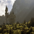 Neuschwanstein in the shadow of the great mountain — Stock Photo