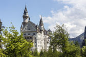 Neuschwanstein castle among spring greenery — Stock Photo