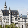 Neuschwanstein above surrounding country — Stock Photo #26980271