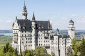 Neuschwanstein above the surrounding country — Stock Photo