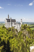 Neuschwanstein Castle above the forest — Stock Photo