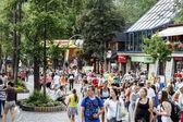 Unidentified tourists visits at the Krupowki street — Stock Photo