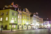Townhouses at the Castle Square at night, Warsaw — Stock Photo