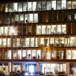 Stock Photo: Lights in windows of office building