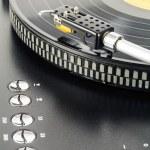 Turntable plays vinyl record — Stock Photo
