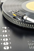 Turntable plays vinyl record — Stock Photo