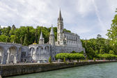 The Basilica of Lourdes at Gave de Pau river — Stock Photo