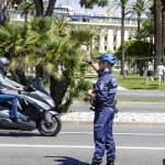 Municipal Policeman directs traffic in Nice — Stock Photo #47871353
