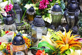 Extinguished candles on graves — Stock Photo
