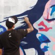 Постер, плакат: Madrid SPAIN Sep 18 graffiti artists work on their creations