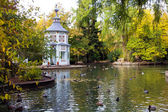 Fall in a lake with marble temple — Stock Photo