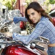 Beautiful sexy woman on a red motorbike — Stock Photo