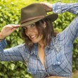 Beautiful woman with blue shirt and hat small — Stock Photo