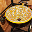 Washbasin with old prints in yellow — Stockfoto