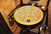 Washbasin with old prints in yellow — Foto de Stock