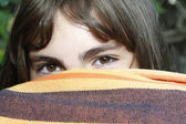 Shameful girl pokes her eyes after a fabric — Stock Photo