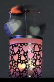 Beautiful candle holder with hearts grinder — Stock Photo