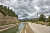 Water channel with mostly cloudy skies — Stock Photo