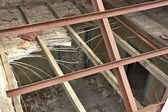 Destroyed house roof detail — Stock Photo