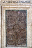 Old wooden door in front of a house — Foto Stock