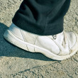 Stock Photo: Sandy sneaker stepping