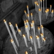 Black and white candles with colored flames — Stock fotografie