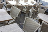 Wicker chairs and tables outside — Stock Photo