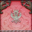 Stok fotoğraf: Nobility old box with wood and decorated with red cloth emblem