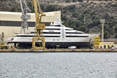 Modern yacht in the yard getting ready for launch — Stock Photo