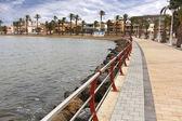 Promenade with modern varandilla by the sea — Stock Photo