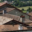 Roofs with chimneys of small town — Stock Photo