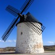 Old Windmill XVI century white stone and wood — Stock Photo #26940673
