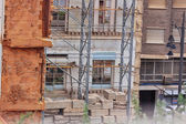 Old facades on reconstruction with scaffolding — Stock Photo