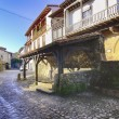 Stok fotoğraf: Streets typical of old world heritage village of Santillandel