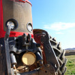 Stock Photo: Front of modern red tractor