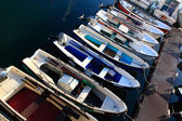 Many rowing boats and fishing engine nice colors — Stock Photo