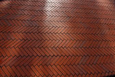 Background made with red bricks in a herringbone — Stock Photo