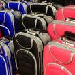 Modern bags for traveling of many colors — Stock Photo