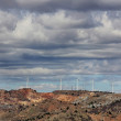 Mountain full of windmills to generate electrical energy and clo — Stock Photo