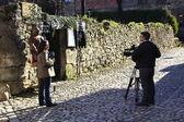 Santillana del Mar, SPAIN Mar 25: Unit Radio Television Española working on the street with presenter and camera of mobile on March 25, 2013 in Santillana del Mar — Стоковое фото