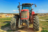 Front of a modern red tractor — Stock Photo
