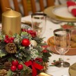 Elegant Christmas table decorated with typical and colorful obje — Stock Photo #35442099