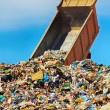 Unloading truck in a mountain of trash — Stock Photo
