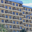 Modern building full of apartments and many balconies — Stock Photo #36037969
