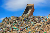 Unloading truck in a mountain of trash — Stok fotoğraf