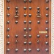 Old wooden door with iron ornaments — Stock Photo