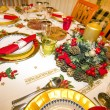 Elegant Christmas table decorated with typical and colorful obje — Stock Photo #36218967