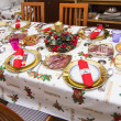 Elegant Christmas table decorated with typical and colorful obje — Stock Photo #36218975